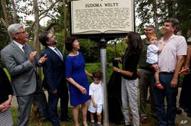 Jon Parrish Peede, chairman of the National Endowment for the Humanities, second from left, joins Gov. Phil Bryant, left, and members of celebrated writer Eudora Welty's family in unveiling the inaugural Mississippi Writers Trail marker, outside Welt