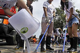 Bangkok Residents Clean Up after Flood