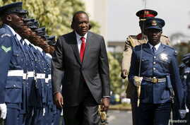 Kenya's President Uhuru Kenyatta inspects a guard of honor before the annual State of the Nation address at the Parliament Buildings in Nairobi, March 31, 2016.