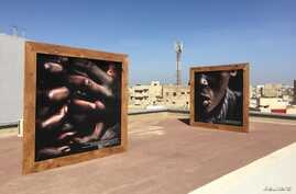 """Photographs by street children displayed at the """"Look at me"""" exhibition, Dakar, Senegal, May 11, 2018."""