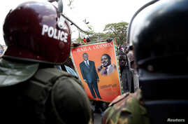 Riot policemen stand guard as supporters of Kenyan opposition National Super Alliance (NASA) coalition protest in Nairobi, Kenya, Oct. 11, 2017.