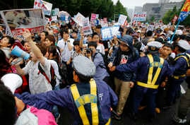 Protesters stage a rally in front of the National Diet building in Tokyo, Aug. 30, 2015.