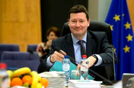 FILE - Secretary-General of the Commission Martin Selmayr waits for the start of a meeting at EU headquarters in Brussels, March 7, 2018.