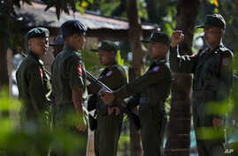 FILE - Trainees stand at attention at an army training base in Pathein, Irawaddy, Myanmar.