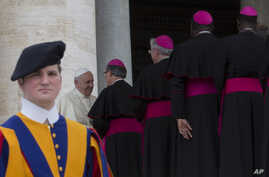 Pope Francis greets bishops at the end of his weekly general audience, at the Vatican, April 30, 2014.