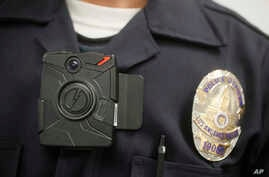 FILE - A  Los Angeles Police officer wears an on-body camera during a demonstration in Los Angeles.