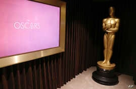 FILE - A giant Oscar statue is seen at The Oscars Greenroom in Los Angeles, California, Feb. 22, 2017.