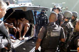 Suspects are arrested after violent clashes with Brazilian Army soldiers in Rio de Janeiro, Brazil, Aug. 20, 2018.