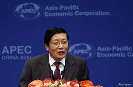 Chinese Finance Minister Lou Jiwei makes a speech at the APEC finance ministers meeting opening ceremony in Beijing, Oct. 22, 2014.