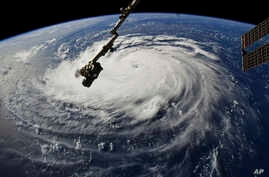 Photo provided by NASA shows Hurricane Florence from the International Space Station on Sept. 10, 2018, as it threatens the U.S. East Coast.