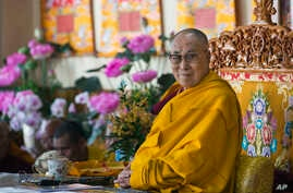 Tibetan spiritual leader the Dalai Lama sits on his ceremonial chair as he presides over the inauguration of the Namgyal Monastery School in Dharmsala, India, Nov. 2, 2017.