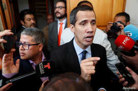Venezuelan opposition leader and self-proclaimed interim president Juan Guaido talks to the media before a session of the Venezuela's National Assembly in Caracas, Venezuela, Jan. 29, 2019.