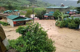 Submerged houses damaged by landslide and floods are seen in Lai Chau province, Vietnam, June 25, 2018. (Vietnam Red Cross/Ta Hong Long/Handout via Reuters)