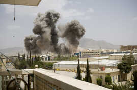 Smoke billows from a Saudi-led airstrike on Sanaa, Yemen. A state-run broadcaster in Iran is reporting that the Islamic Republic has sent a navy destroyer and another vessel to waters near Yemen amid a Saudi-led airstrike campaign, April 8, 2015.