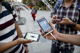 Iranians play Pokemon Go in northern Tehran's Mellat Park, Aug. 3, 2016. Iran was quick to ban global gaming craze but as with many of the Islamic republic's internet controls, tech-savvy youngsters have carried on regardless.