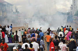 A photo taken on September 28, 2012 in Conkary, Guinea shows youth in the street during the funeral procession for two young opposition supporters killed by police during recent clashes.