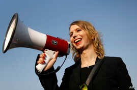 FILE - Chelsea Manning addresses participants at an anti-fracking rally in Baltimore, April 18, 2018. Chelsea Manning, who leaked classified documents, will not be allowed to enter Australia for a speaking tour scheduled to start Sunday.