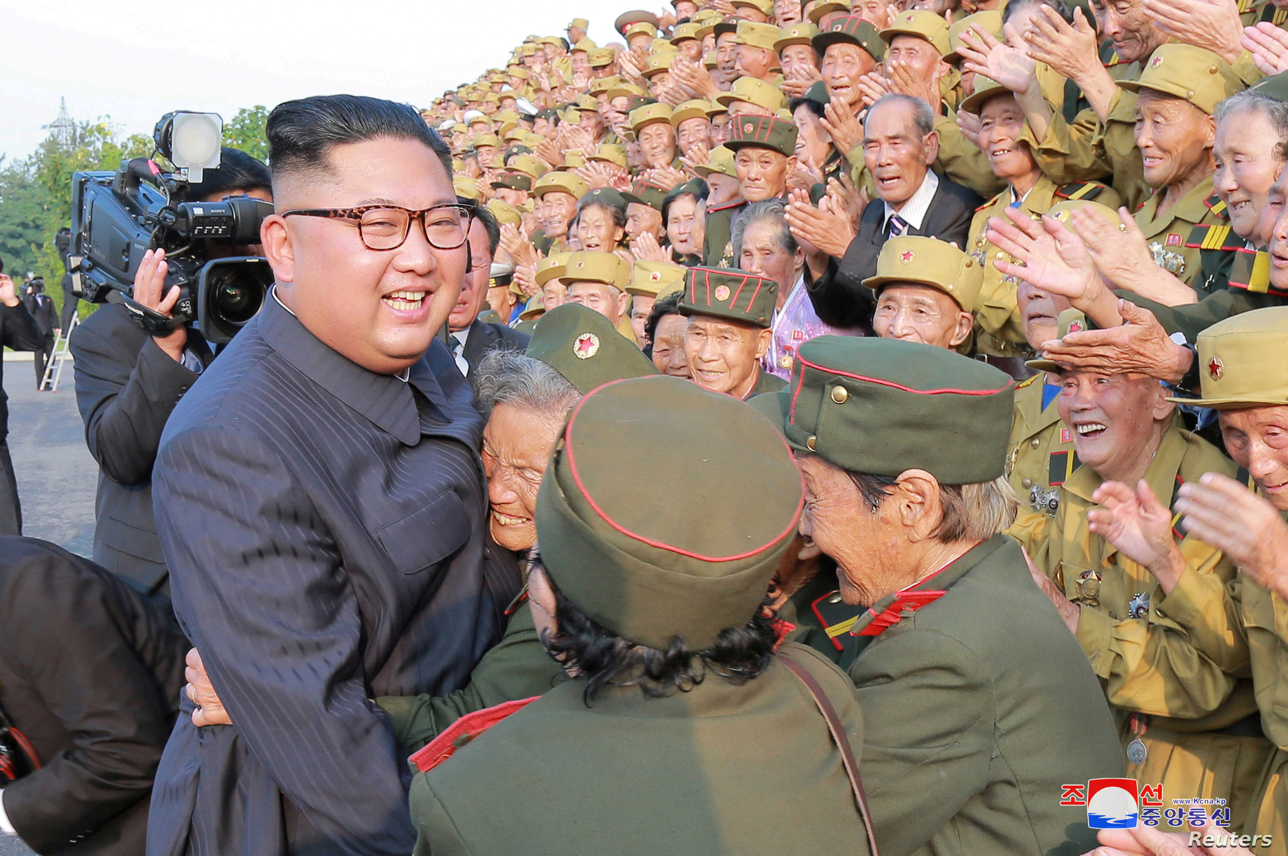 North Korean leader Kim Jong Un meets participants of the 5th National Conference of War Veterans in this undated photo released by North Korea's Korean Central News Agency (KCNA) on July 27, 2018.