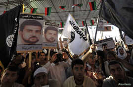 People hold posters of senior al Qaida figure Abu Anas al-Liby (L) during a demonstration over his capture by U.S. authorities, in Benghazi, Oct. 11, 2013.