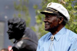 Legendary musician Chuck Berry sits on a stage next to a statue of himself during its dedication, July 29, 2011, in University City, Mo. The statue of the St. Louis native was dedicated near Blueberry Hill, the University City club where the octogen