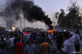 People gather during a protest near the main provincial government building because of the water pollution and poor services in Basra, Iraq, Aug. 31, 2018.