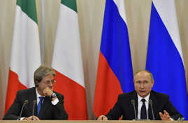Russian President Vladimir Putin, right, and Italian Prime Minister Paolo Gentiloni attend a joint news conference at the Bocharov Ruchei state residence in Russian Black Sea resort of Sochi, May 17, 2017.