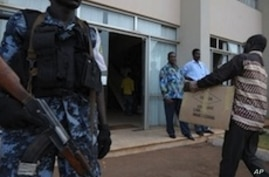 Togolese police forces stand guard at gate as electoral Commission members arrives with the ballot result papers on March 6, 2010 in Lome