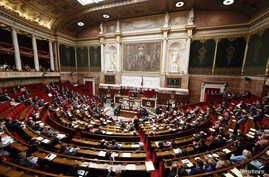 FILE - A general views shows the hemicycle as French Prime Minister Manuel Valls delivers a speech during a parliamentary debate on Iraq at the National Assembly in Paris, Sept. 24, 2014.