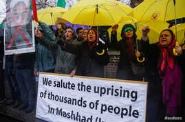 Opponents of Iranian President Hassan Rouhani hold a protest outside the Iranian embassy in west London, Dec. 31, 2017.