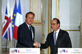 French President Francois Hollande (R) shakes hands with Britain's Prime Minister David Cameron during a joint news conference Nov. 23, 2015, at the Elysee Palace in Paris.