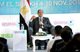 FILE - In this Nov. 7, 2017 photo, Egyptian President Abdel-Fattah el-Sissi participates in a meeting with a group of young people at the 'World Youth Forum,' a government-organized event in Sharm el-Sheikh, Egypt.