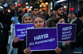 "Supporters of the 'NO' vote, (""Hayir"" in Turkish) participate in a protest against the referendum outcome, in Istanbul, Friday, April 21, 2017."