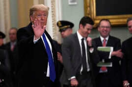 President Trump waves as he leaves after attending the weekly Republican policy luncheon on Capitol Hill in Washington, Tuesday, March 26, 2019.