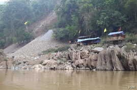 Chinese engineers doing test drilling for the Mong Ton Dam on the Salween River.