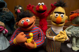 Bert and Ernie, as well as Elmo, center, are among a donation of additional Jim Henson objects to the Smithsonian's National Museum of American History in Washington, Sept. 24, 2013.