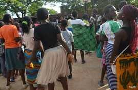 A group of young girls in Malawi at a basketball court in Blantyre. (Lameck Masina for VOA News)
