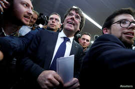 Sacked Catalan leader Carles Puigdemont departs after a news conference at the Press Club Brussels Europe in Brussels, Belgium, Oct. 31, 2017.