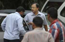 Satyam Computer Services founder B. Ramalinga Raju, center, arrives at a court in Hyderabad, India, Monday, March 9, 2015.