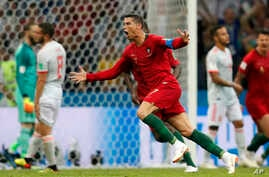 Portugal's Cristiano Ronaldo celebrates after he scored his third goal with a free kick during a group B  draw, 3-3, with Spain at the 2018 World Cup in the Fisht Stadium in Sochi, Russia, June 15, 2018.