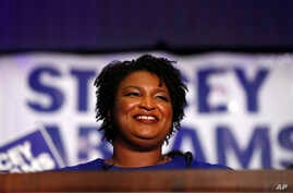 FILE - Democratic candidate for Georgia Governor Stacey Abrams speaks during an election-night watch party, May 22, 2018, in Atlanta.