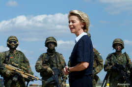 FILE - German Defense Minister Ursula von der Leyen visits the Transport Helicopter Regiment 30  in Niederstetten, Germany, Aug. 20, 2018.