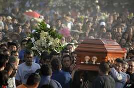 Mourners carry the coffin of slain mayor of Temixco, Gisela Mota, to the cemetery in Pueblo Viejo, Mexico, on Jan. 3, 2016.