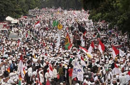 Muslim protesters march during a demonstration in Jakarta, Indonesia, Friday, Nov. 4, 2016. Tens of thousands of hard-line Muslims converged Friday on the center of the Indonesian capital to demand the arrest of its minority-Christian governor for al...