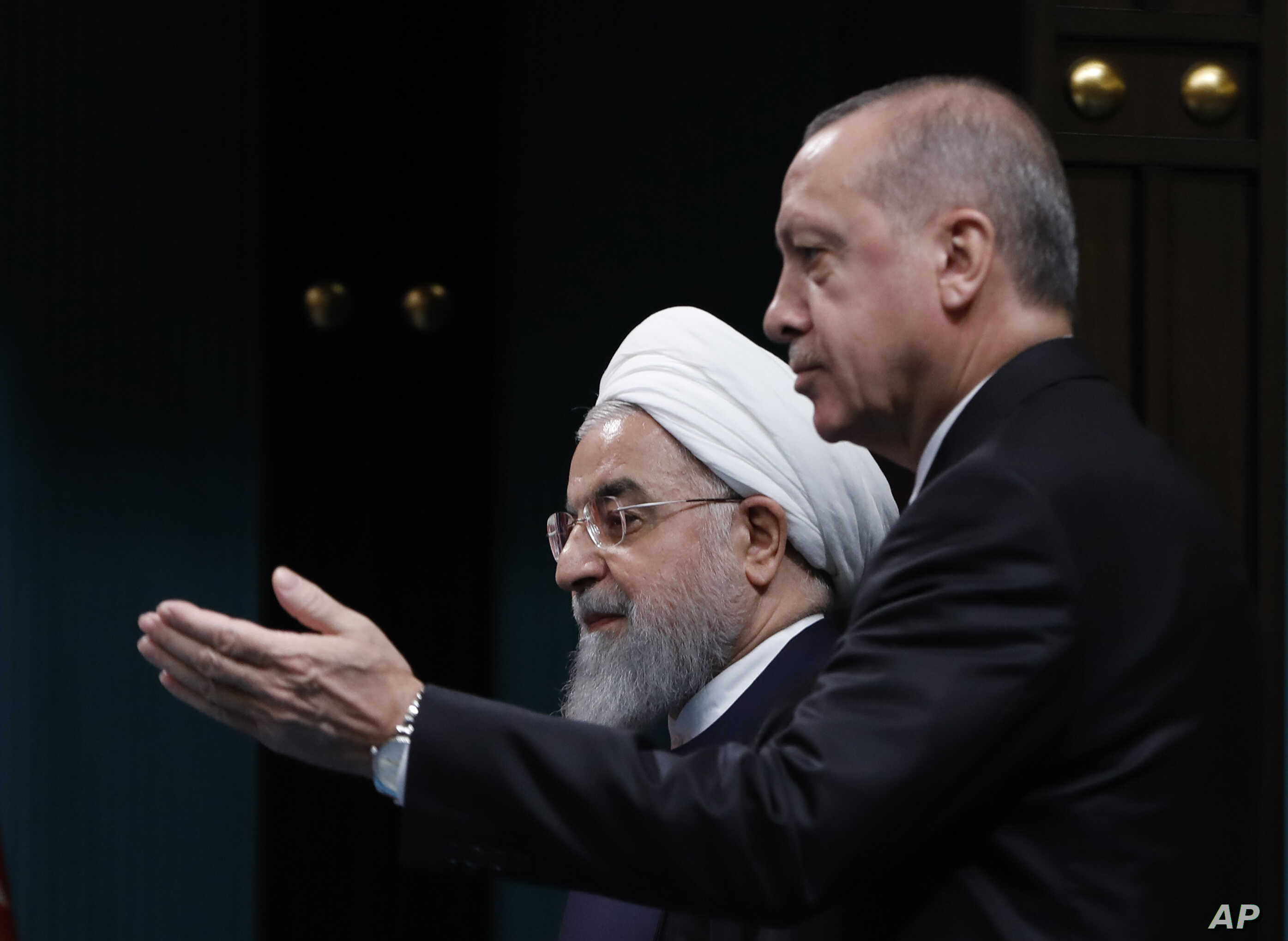 Turkey Iran SyriaTurkey's President Recep Tayyip Erdogan, right, gestures to Iran's President Hassan Rouhani, as they arrive for a news conference following their meeting at the Presidential Palace in Ankara, Dec. 20, 2018.