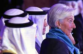 The head of the International Monetary Fund, Christine Lagarde, right, attends an international conference on Islamic finance, in Kuwait City, Nov. 11, 2015. She has urged Gulf countries, hurt by falling oil prices, to consider scaling back subsidies