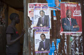 A boy enters an house with various campaign posters at the Kangemi slum in Kenya's capital Nairobi, Feb. 28, 2013.