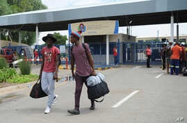 FILE - Students leave the campus at the North-West University in Mahikeng, South Africa, (also known as Mafikeng) Feb. 25, 2016.