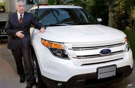 FILE - Ford Japan Chief Executive Timothy Tucker introduces the new Ford Explorer in Tokyo, May 24, 2011. Automaker Ford Motor Co. said Jan. 25, 2016, it will close all operations in Japan and Indonesia this year.