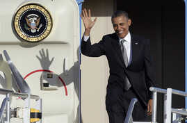 President Barack Obama waves as he arrives at Miami International Airport, Nov. 8, 2013, in Miami.