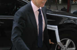 Greece's finance minister Yannis Stournaras arrives for a meeting between Greek officials and the debt inspectors from the European Central Bank, European Commission and International Monetary Fund, known as the troika at Greece's Finance ministry in